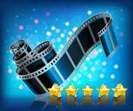 Film and stars. On blue background Stock Photos