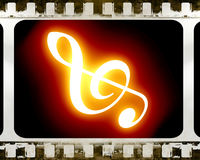 Film strip. Old film strip with a music note in it Royalty Free Stock Photography