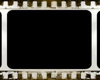 Film strip. Old film strip with some damage in it Royalty Free Stock Photos