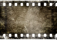 Film strip. 35 mm film strip on grunge background Royalty Free Stock Image