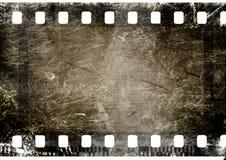 Film strip. 35 mm film strip on grunge background Royalty Free Stock Image