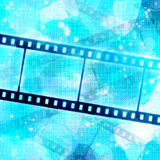 Film strip. On glowing blue background Royalty Free Stock Images