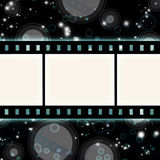 Film strip. On glowing blue background Royalty Free Stock Image