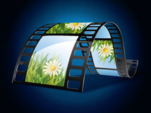 Film strip. On blue background Stock Photography