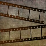 Film strip. Old film strip on grungy background Stock Images