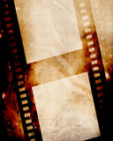 Film strip. Old film strip on a grunge background Royalty Free Stock Photography
