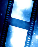 Film strip. Old film strip on a blue background Stock Photography