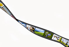Film strip. With vacation snap shots Royalty Free Stock Photo