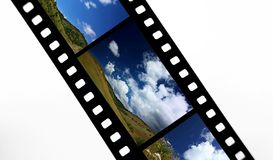 Film strip. With landscape snap shots Royalty Free Stock Photo
