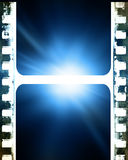 Film strip. Old film strip on a blue background Royalty Free Stock Image