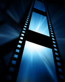 Film strip. Old film strip on a blue background Stock Image