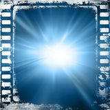 Film strip. Old blue film strip with some damage on it Stock Image