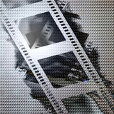 Film strip. Old film strip on a metal plate background Royalty Free Stock Photos