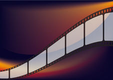 Film strip. On the orange and red background Stock Photography