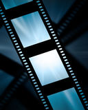 Film strip. Old film strip on a blue background Royalty Free Stock Images