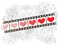 Film strip banner on spotted pattern with hearts. Royalty Free Stock Photo