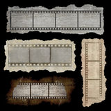 Film strip banners. Collection of four banners with film strip in grunge style isolated on black background Stock Photo
