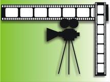 Film strip and cinecamera. Green background with film strip and cinecamera Stock Photography