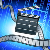 Film strip and clapper board on blue background Royalty Free Stock Photo