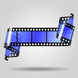 Film strip. Curled blue film strip on gray background. Movies concept. There is in addition a vector format (EPS 10) with transparent objects Stock Photo