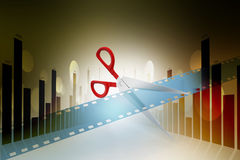 Film strip is cut with scissors. In color background Stock Image