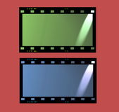 Film strip frame isolated on red background Stock Photos