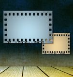 Film strip frames on room interior Royalty Free Stock Photos