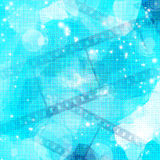 Film strip on glowing blue. Background Royalty Free Stock Images