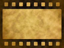 Film strip grunge background 2. Old yellow paper background with film strip Stock Photo