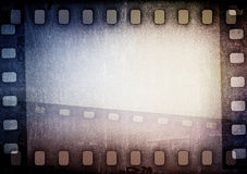 Film strip. Grunge blue film strip background with copy space Royalty Free Stock Image