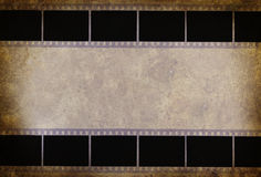 Film strip. Grunge retro background Royalty Free Stock Photos
