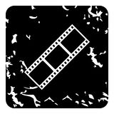 Film strip icon, grunge style. Film strip icon. Grunge illustration of film strip vector icon for web design Stock Photos