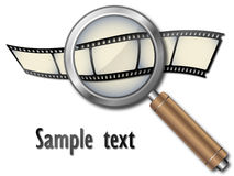 Film strip with magnifying glass.  Royalty Free Stock Photo