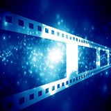 Film strip. Negative film strip on a dark background Stock Photography