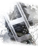 Film strip. Old film strip on a metal plate background Stock Photos