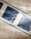 Film strip. Old film strip on a paper like background Royalty Free Stock Images