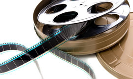 Film Strip, Reel and Can. A container of film strip, film reel and film can on a white background Stock Image