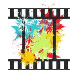 Film strip roll. Grunge vector illustration. Film strip roll on background with color spots. Grunge vector illustration Royalty Free Stock Image