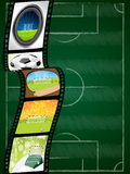 Film strip with soccer field. In background Royalty Free Stock Image