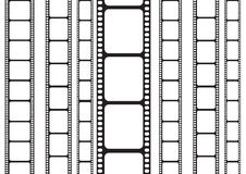 Film strip on a vertical side. Isolated 35 mm film strip Royalty Free Stock Photography