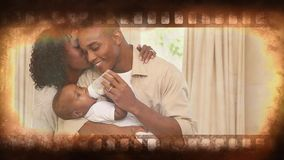 Film Strip video. Film strip showing happy family caring for baby stock video footage
