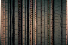 Film strip wallpaper. Brownish film strip background or wallpaper. 3D Rendering Stock Photos