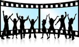 Film strip youth. Silhouettes of people dancing on film strip background Royalty Free Stock Image