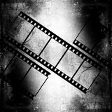 Film strips. Retro grunge background with film strips royalty free illustration