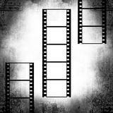 Film strips. Retro grunge background with film strips stock illustration