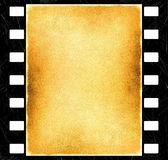 Film strips background. Grunge background with film strips and scratches Stock Photography