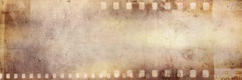 Film strips background. Film negative frames on grunge background Stock Images
