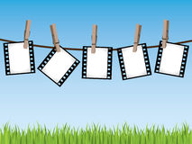 Film strips hanging on a line. Please check my portfolio for more film illustrations Royalty Free Stock Photography
