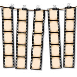 Film strips hanging out to dry Stock Images