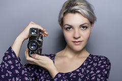 Film Student Holding a Vintage Camera Stock Photo
